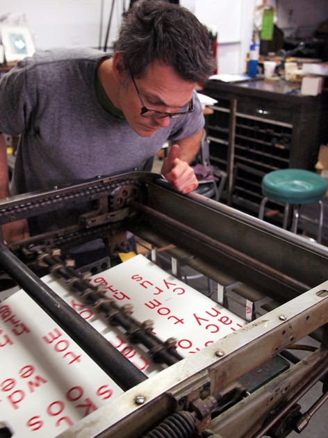 Dan Wood of DWRI Letterpess printing the poster and bookmarks