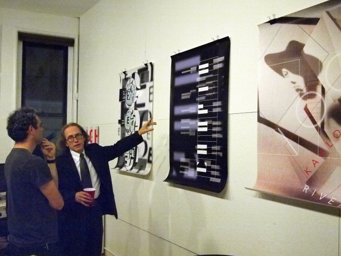 Tom Wedell with three posters that were on view for the event